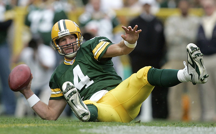 ** FILE ** Green Bay Packers quarterback Brett Favre looks to pass the ball after falling down during the second quarter of their NFL football game in Green Bay, Wis., in this Sept. 10, 2006 file photo. Brett Favre has decided to retire from the NFL after 17 seasons. FOX Sports first reported Tuesday March 4, 2008 that the Green Bay Packers quarterback informed the team in the last few days. (AP Photo/ Morry Gash, file)